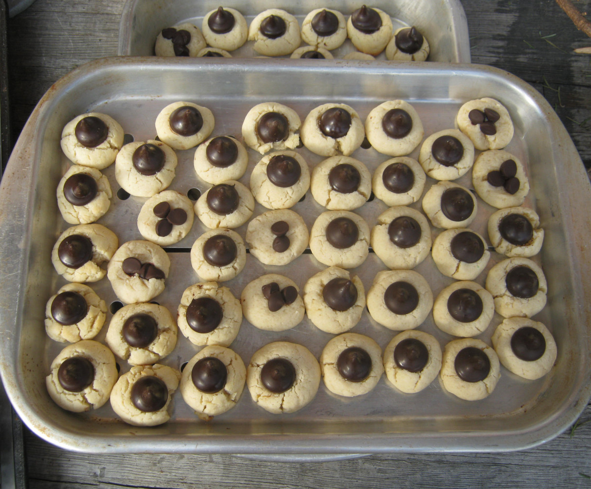 Chocolate Drop Cookies are always a favorite. Simply press a chocolate kiss into the center of a rolled Spritz cookie and bake! Easy and delicious!