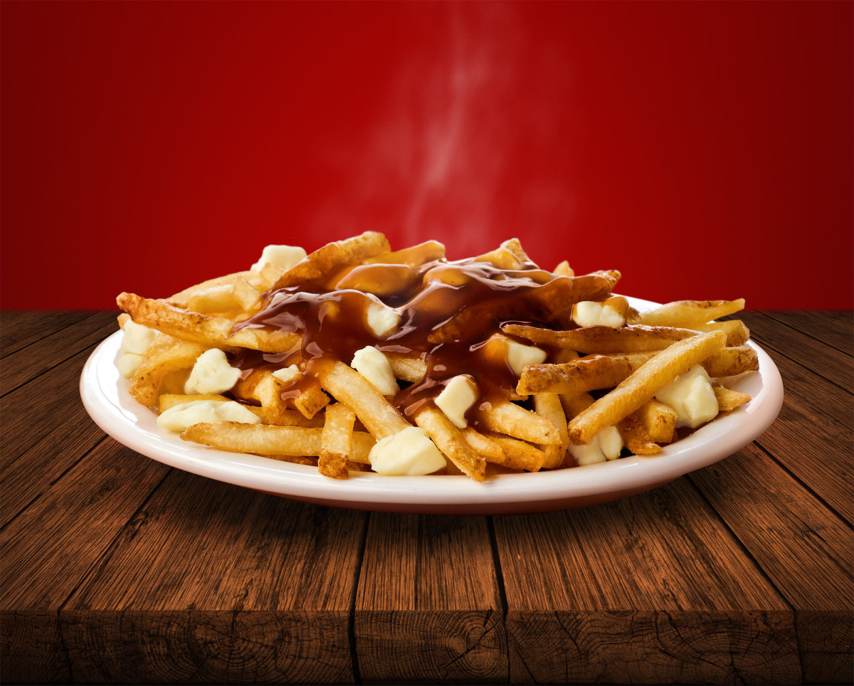 "The promo photo of Wendy's poutine, promising ""The delicious marriage of flavours melts together to create a truly Canadian favourite."""