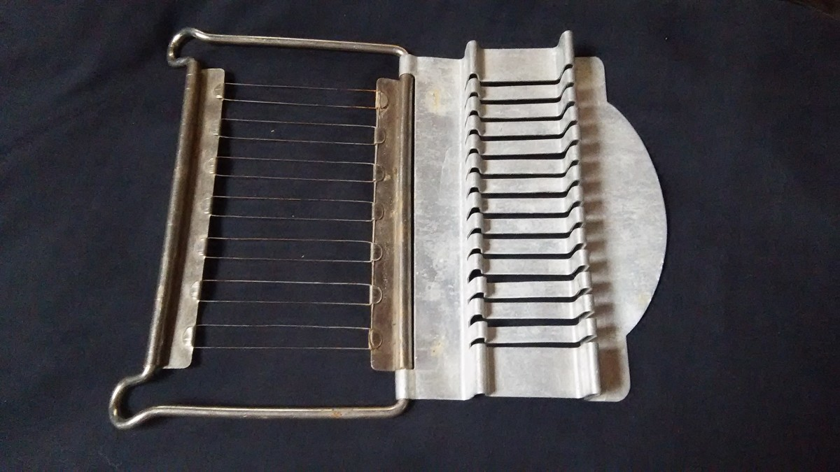 I know this is a stick butter slicer as I used one when working as a waitress and carhop in the '50s.  They are such great gadgets!!