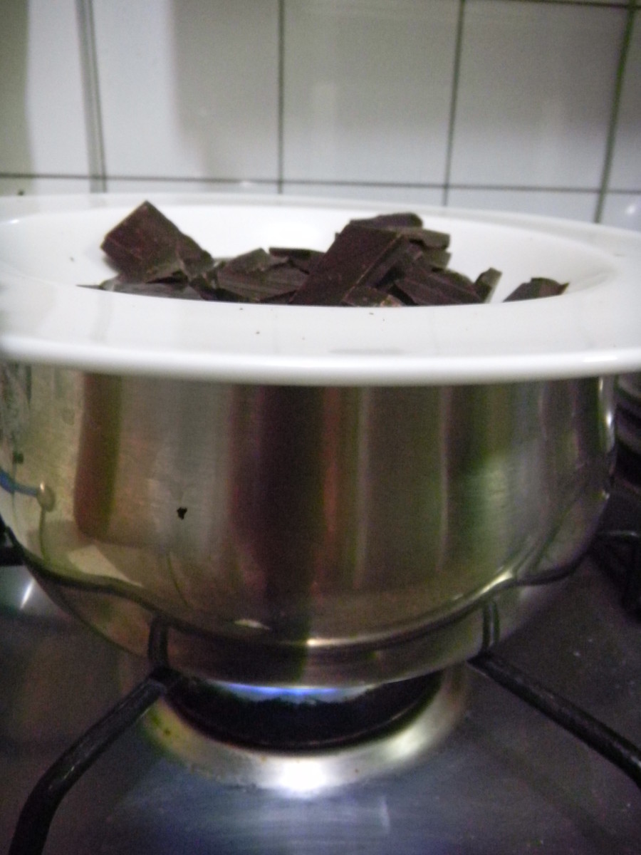 Melt chocolate in a bowl sitting on top of a pan with boiling water