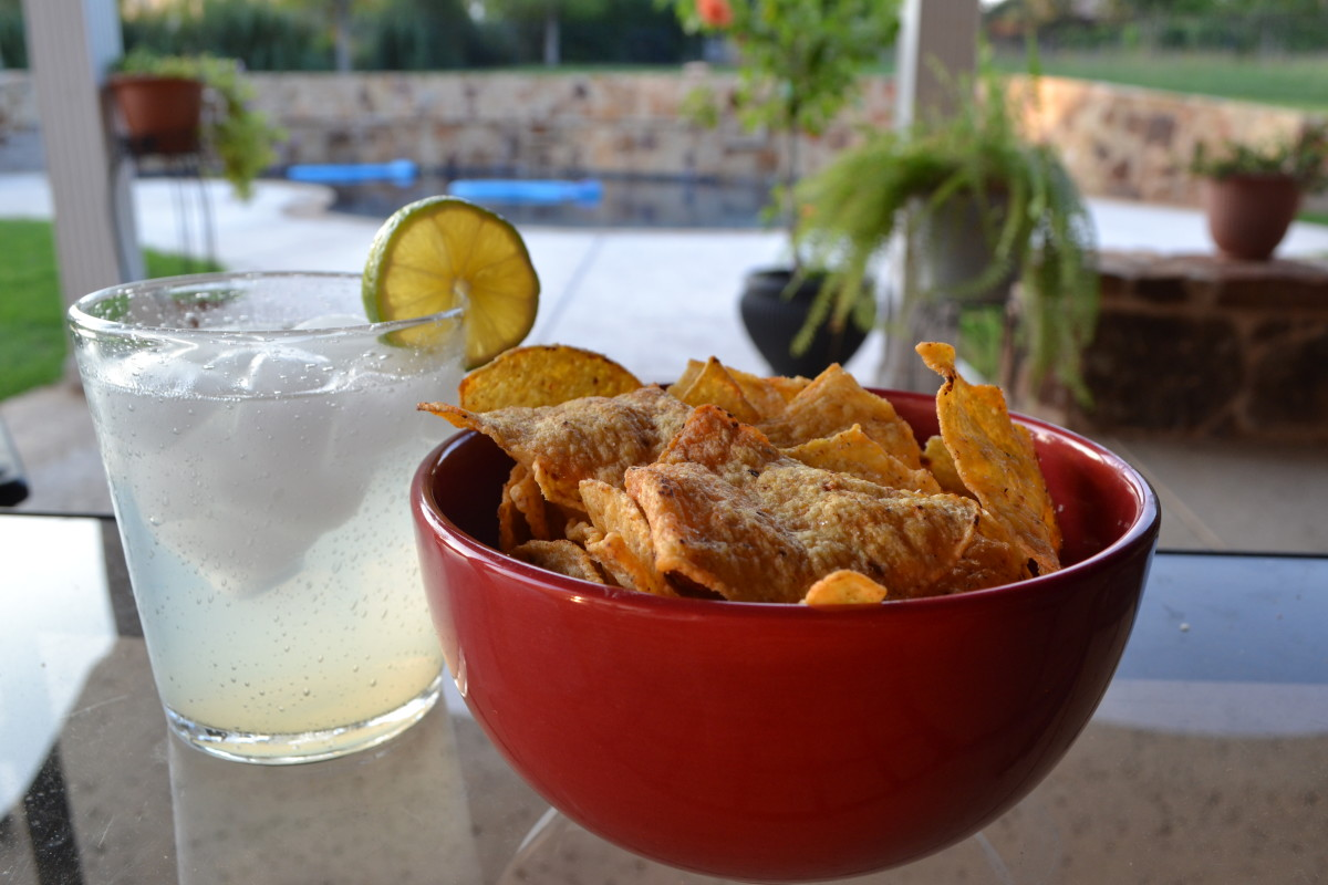 The perfect antidote to a stressful day: a Margarita on the rocks and your own personal bowl of Julio's Chips. (Tell the kids to get their own bowl).