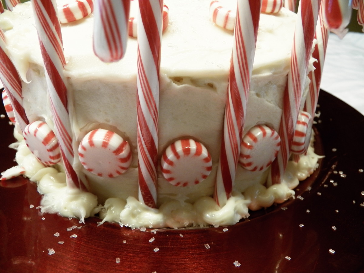 After icing, put candy canes around the cake about 1-2 inches apart.  Then put peppermints inbetween.
