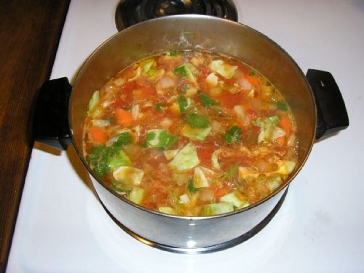 Simmer vegetables and seasonings in the broth after removing ham hocks.