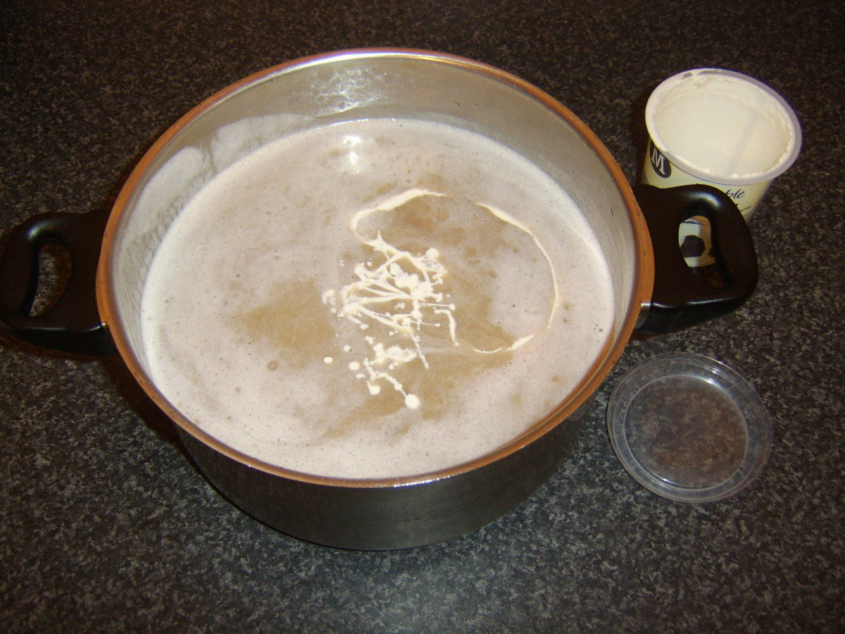 Cream is poured in to the pureed potatoes, chestnuts and duck stock