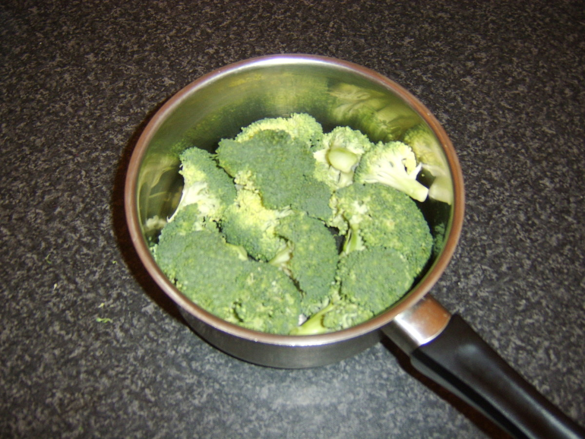 Broccoli is broken in to florets for boiling