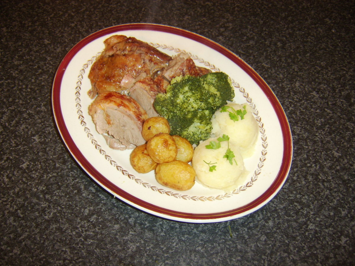 Roast duck with roasted potatoes, mashed potatoes and broccoli