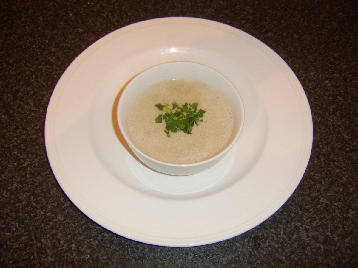 Cream of chestnut and roast duck soup ready for service