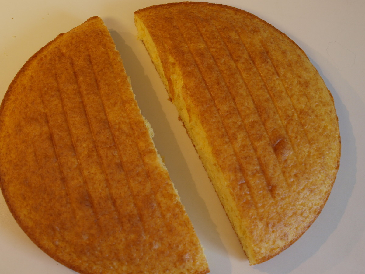 Cut the round cake evenly in half using a sharp knife.  Only cut after cake is completely cooled.