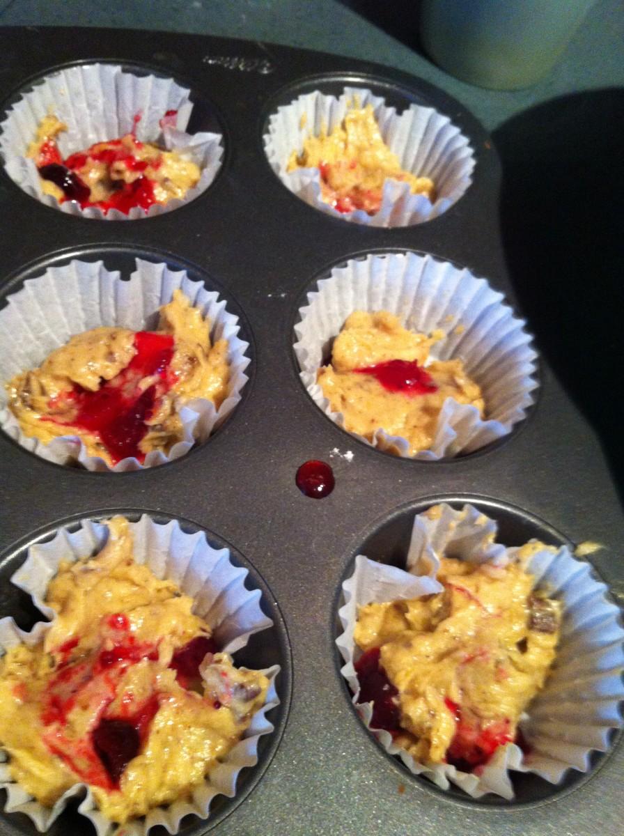 Adding cranberry sauce to my mom's banana muffin recipe.