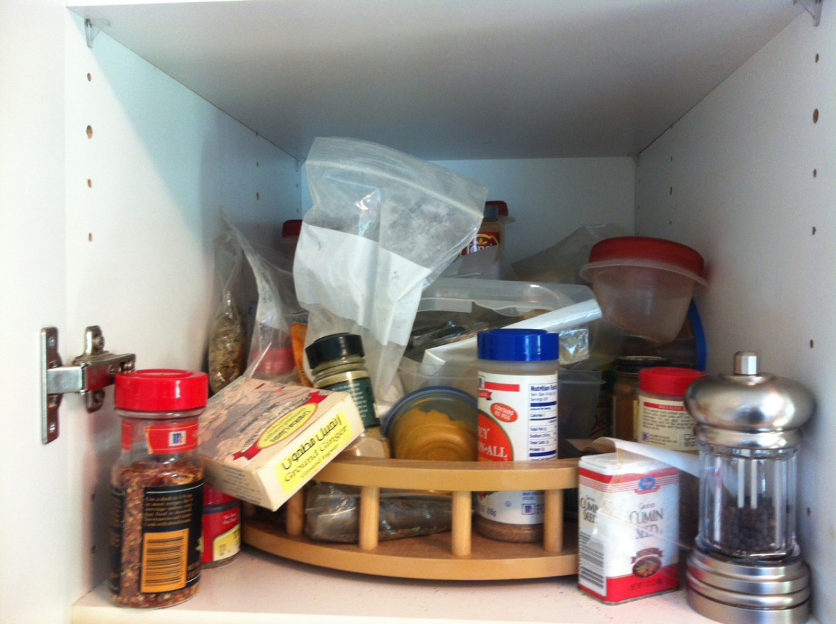 This is what my spice cabinet looked like before I organized it.
