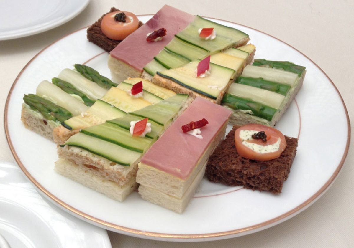 A plate of elegant, stacked, open-face tea sandwiches from the Palace Hotel