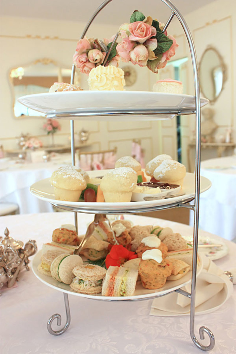 "Tiered serving plate of ""finger food"" sandwiches, scones and desserts"