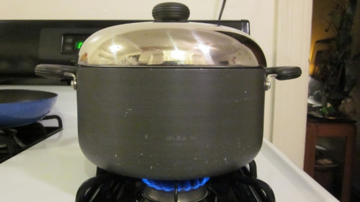 Add sauteed vegetables to browned chicken and water to cook covered in large pot.