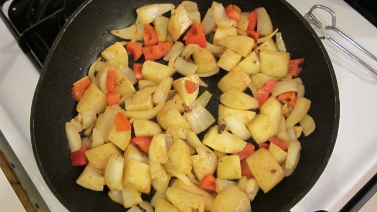 Saute potatoes, onions, and red peppers in same frying pan after chicken.