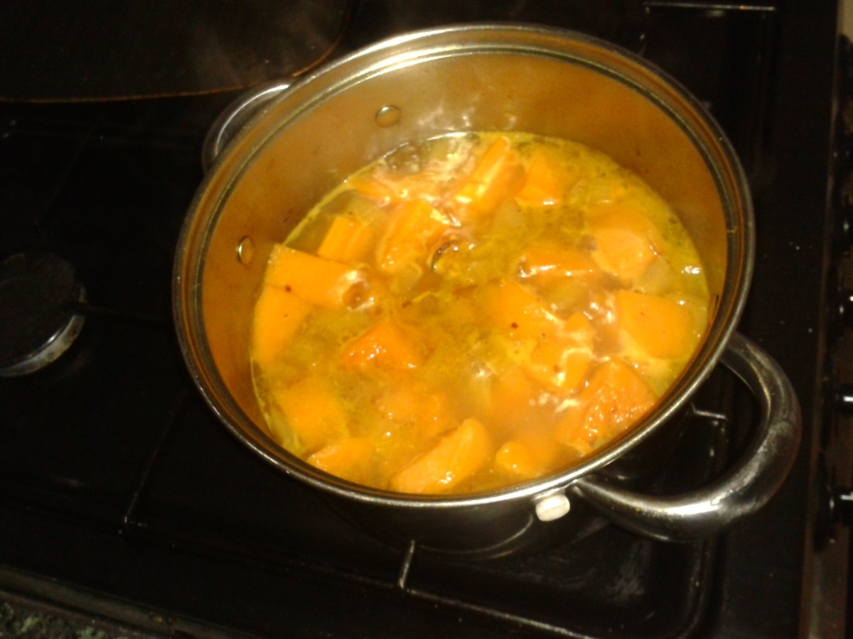 onions, butternut squash and ginger cooking in a pot