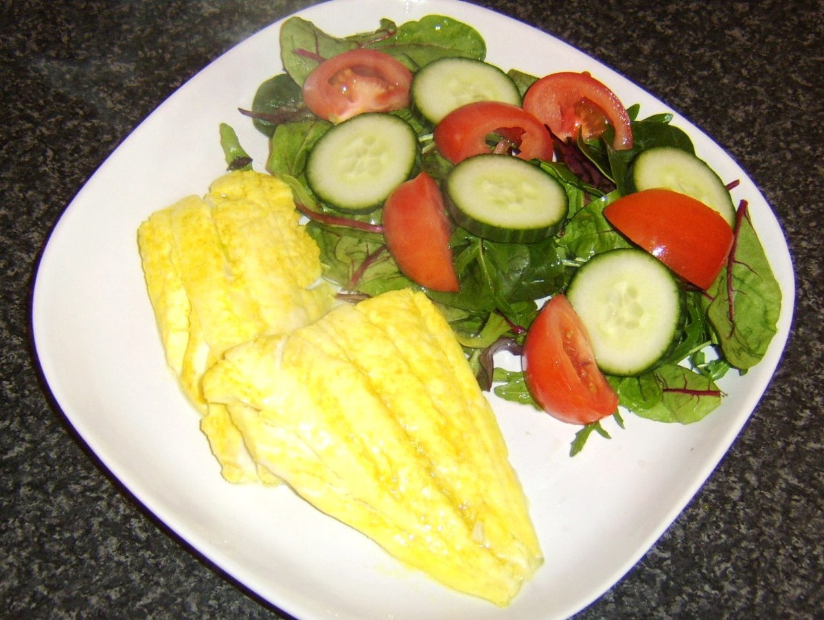 Haddock fillets are briefly marinated in turmeric, salt and lime juice before being pan fried and served with a simple salad