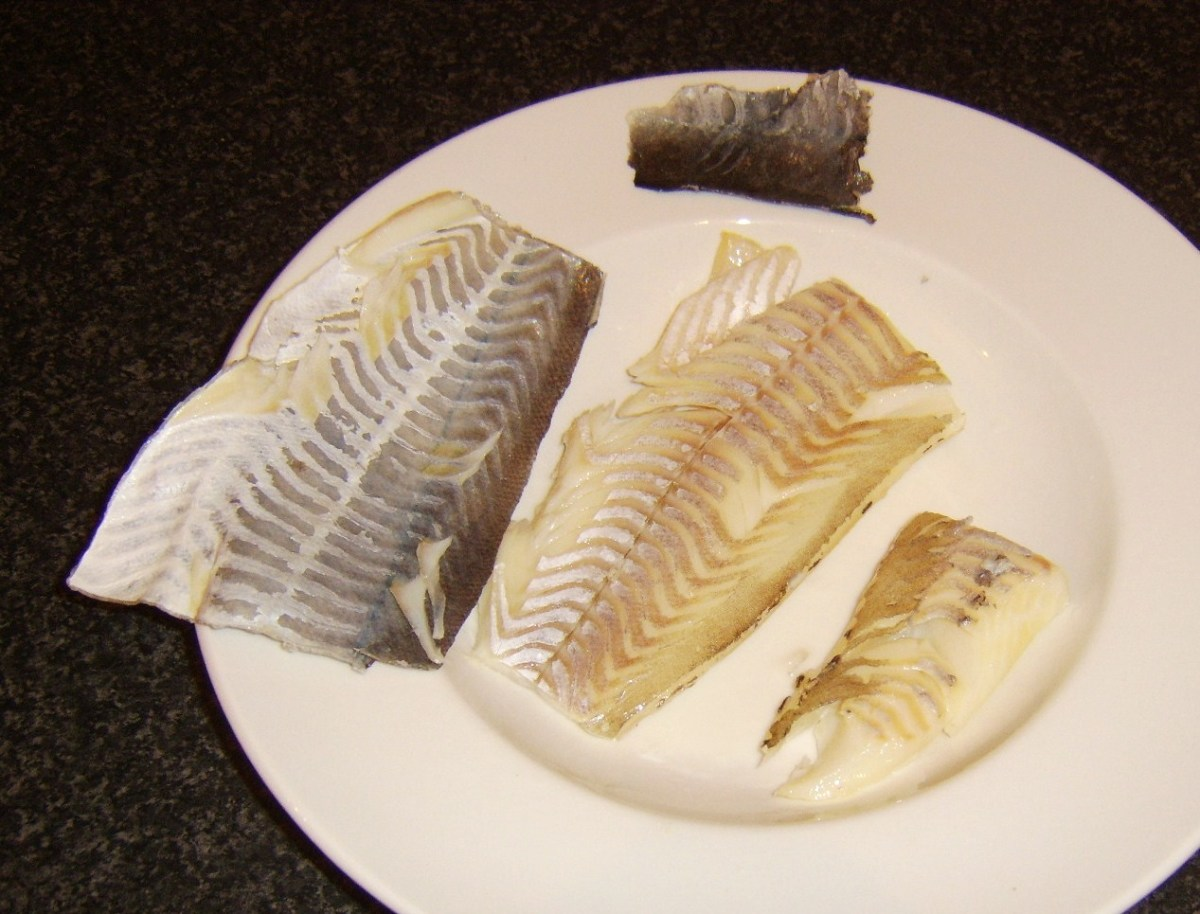 Skin is peeled from smoked haddock