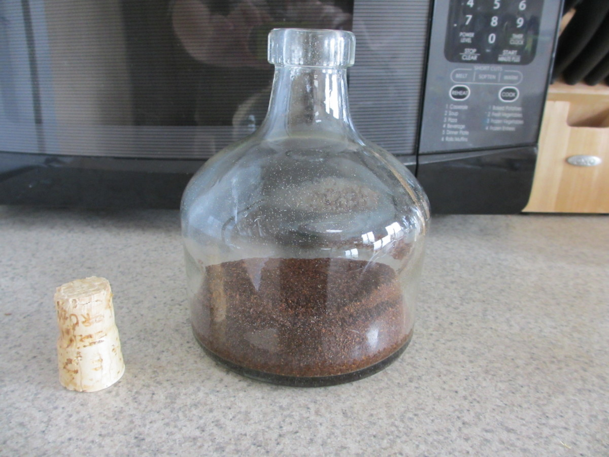 For any size container, fill it about 1/3 full of ground coffee.