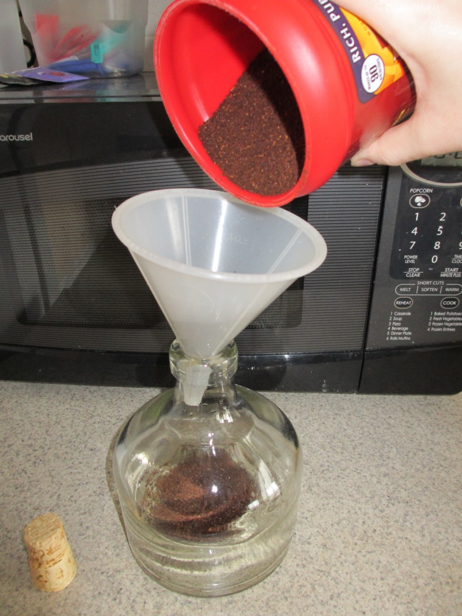 Use the funnel to fill your bottle partway with ground coffee.