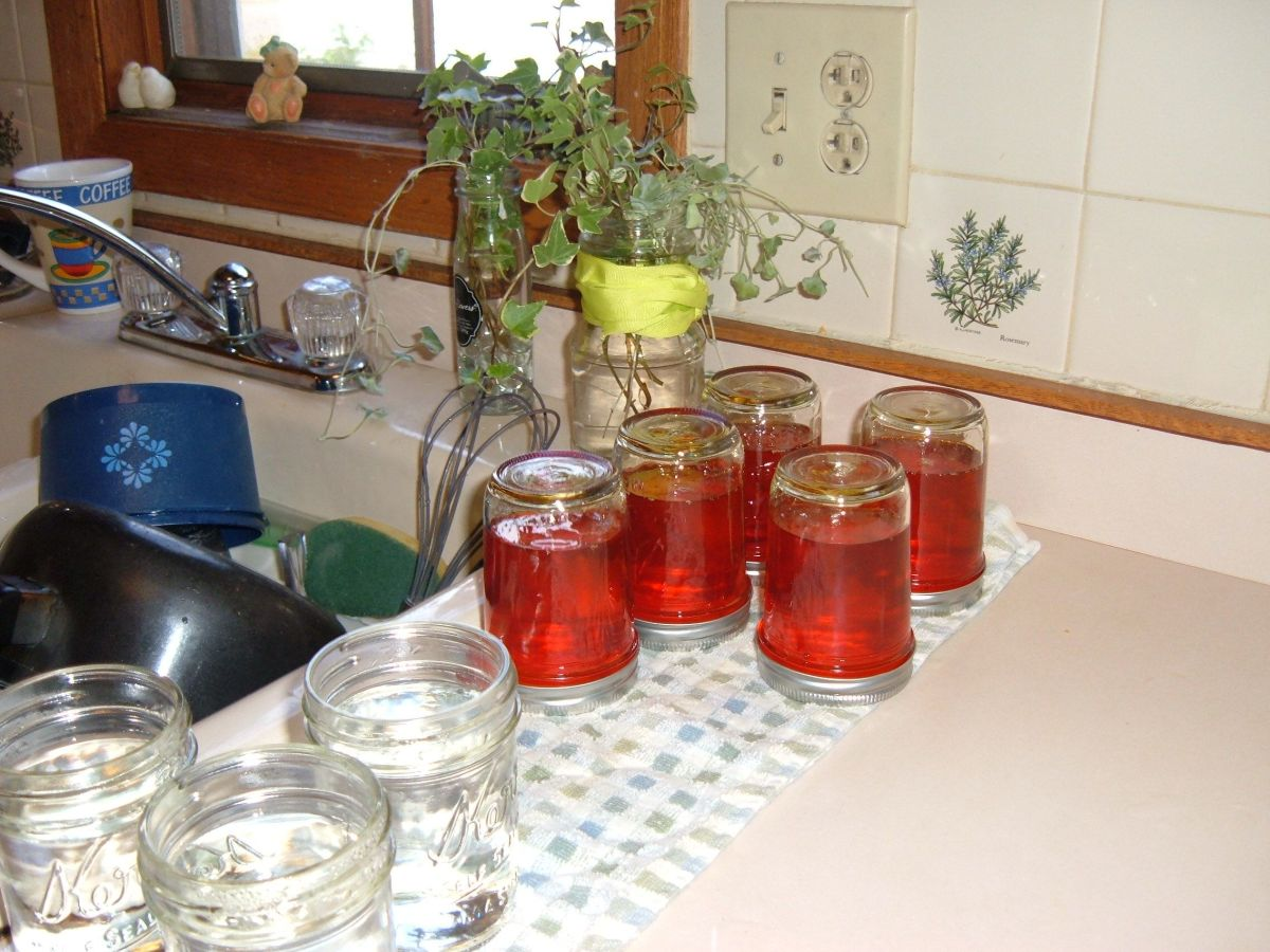 Tip the jars upside down as you finish screwing the lids on. They will sit this way for 5 minutes.