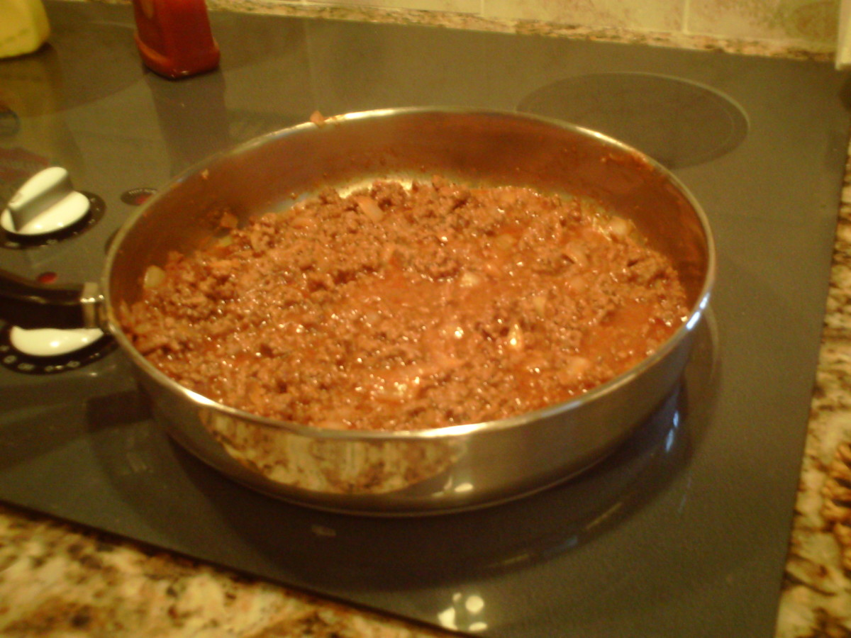 Spanish hamburgers simmering to combine the flavors.