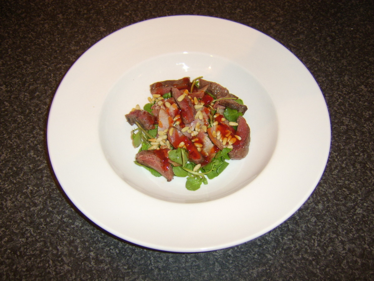 Pigeon breast salad with bacon, watercress, toasted pine nuts and peri peri sauce