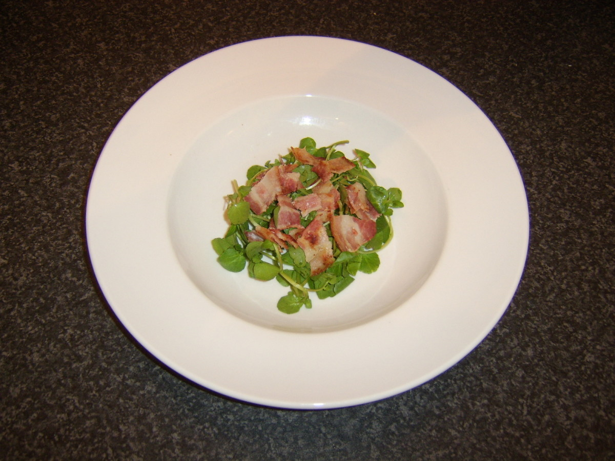Chopped bacon is scattered on watercress