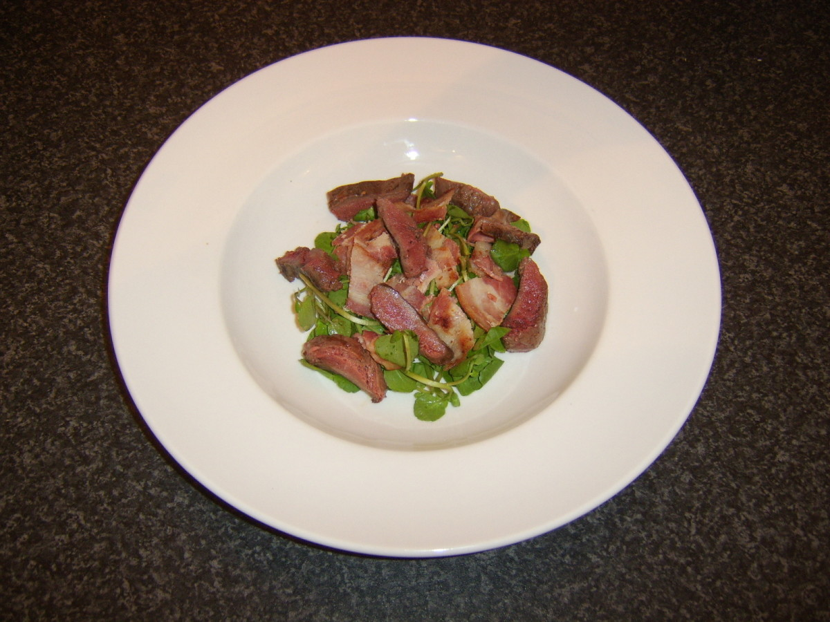 Sliced pigeon breasts are added to the salad