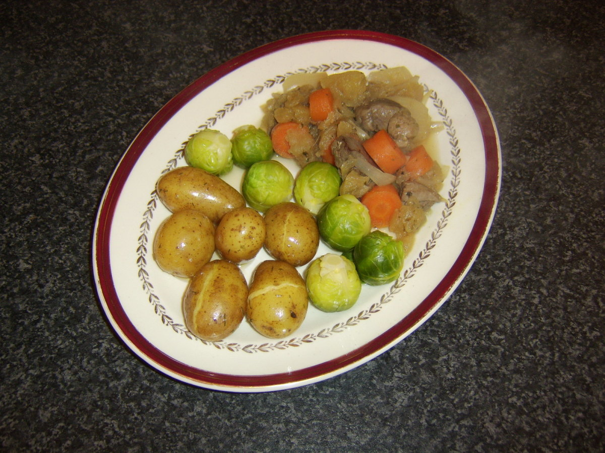 Pigeon breast, apple and sage casserole with boiled new potatoes and Brussels sprouts