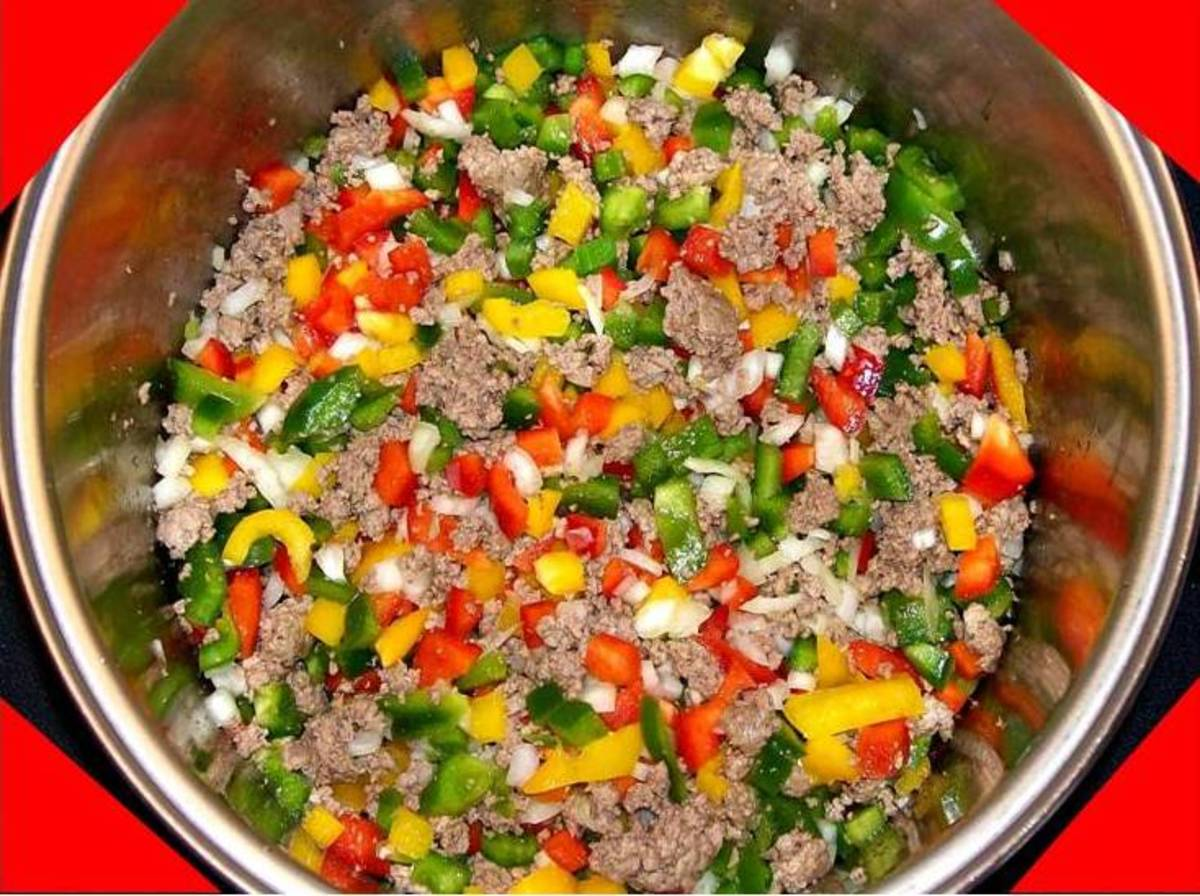 Cook down the vegetables on medium heat for at least 1/2 hour while occasionally stirring.