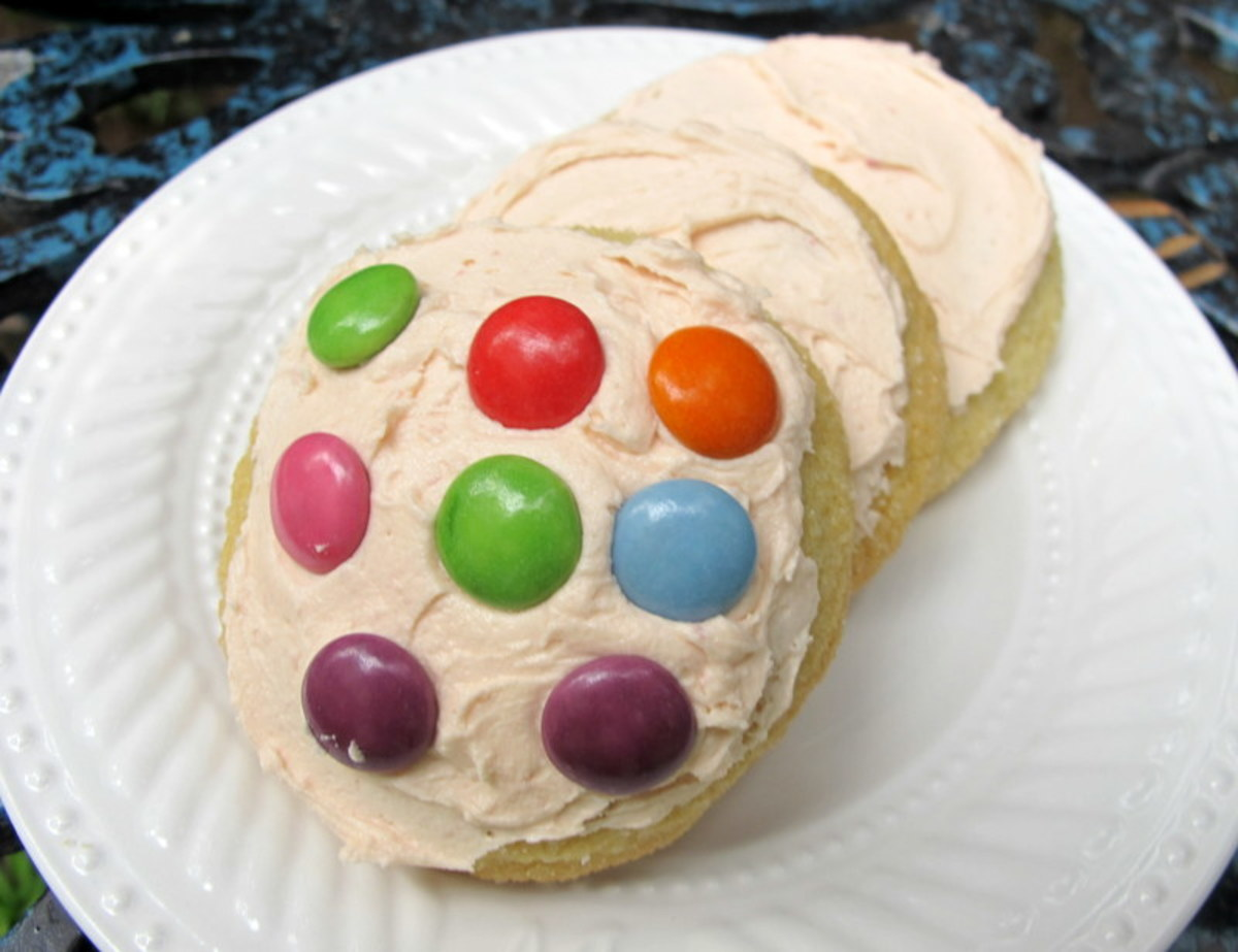 Decorate sugar cookies with brightly colored candies or sprinkles