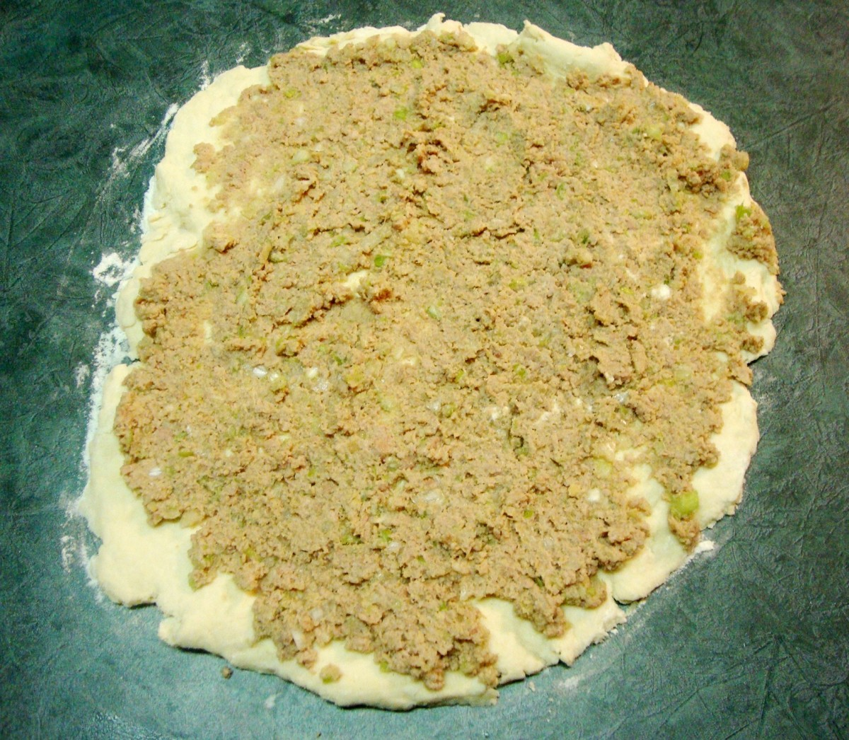 Spreading Turkey Filling Over Biscuit Base