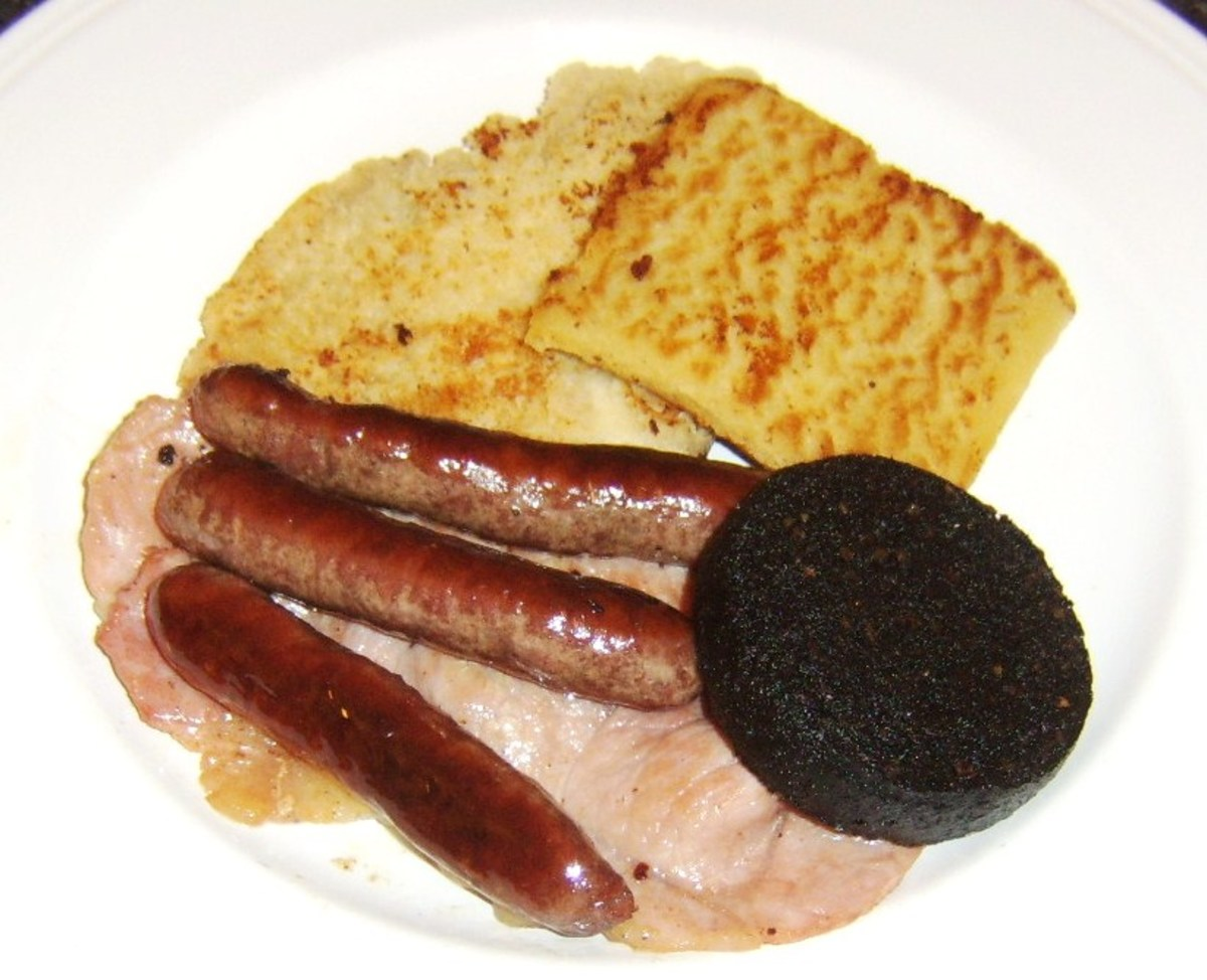 Sausages and black pudding are laid on bacon