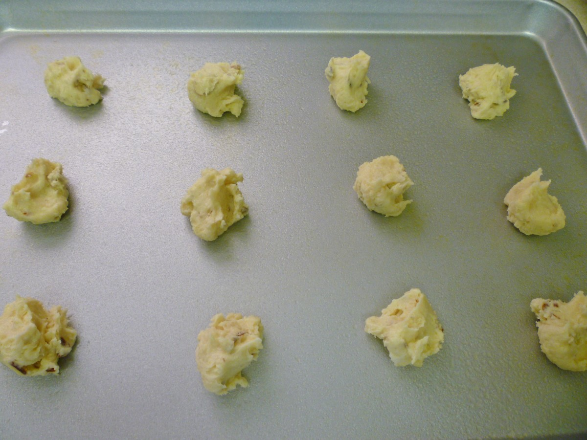 Putting the cookie dough on the cookie sheets.
