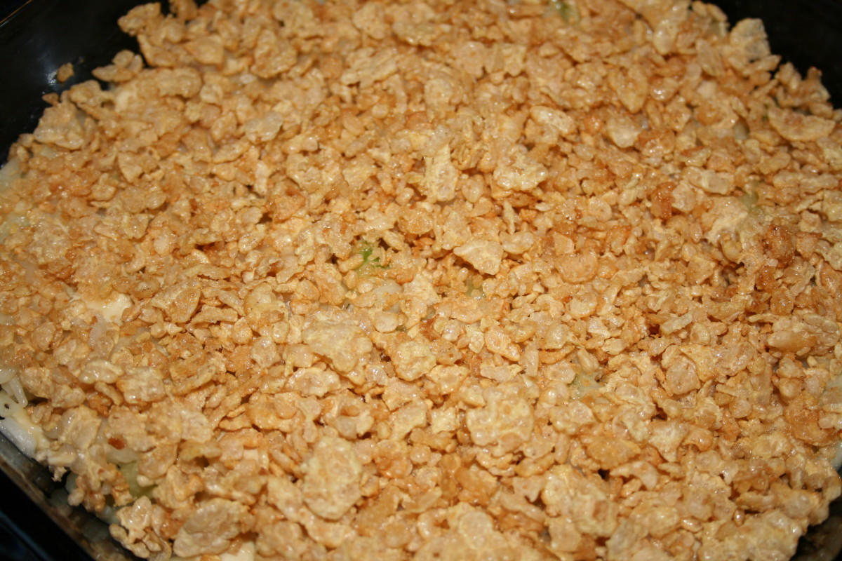 Top it the buttered, crushed cornflakes & pop it into a 350 degree F oven for about 25 minutes.