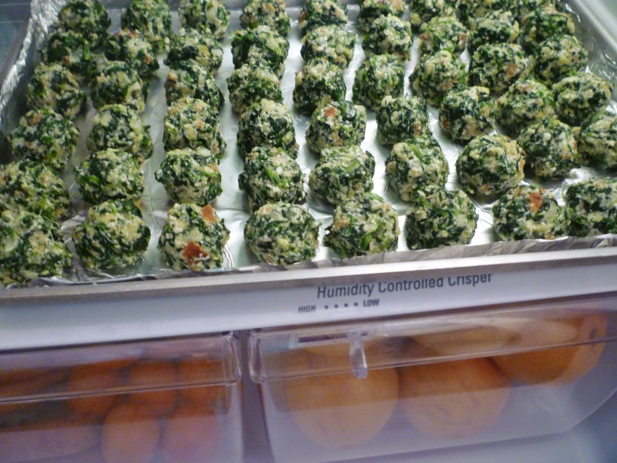 Chilling the spinach balls in the refrigerator prior to baking or freezing.