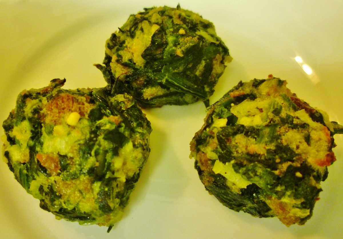 Baked spinach balls ready to be enjoyed.  Just pop them in your mouth.  I'll bet you will want to eat more than one!