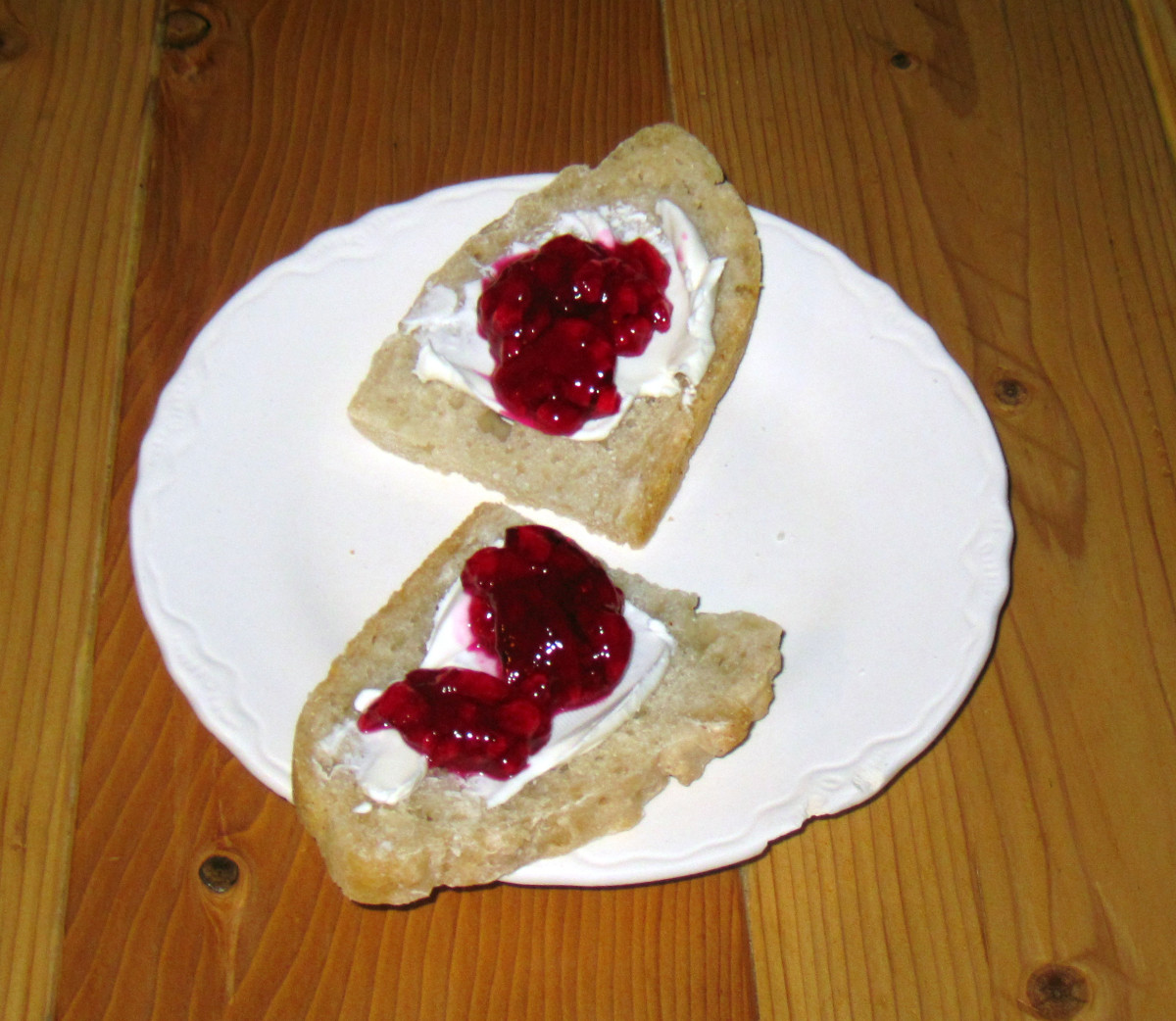 Prickly pear jam, served with cream cheese on homemade bread. Delicious!
