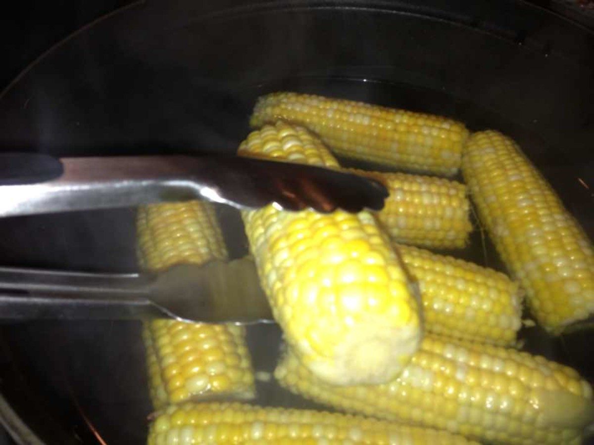 Remove corn from boiling water with tongs.