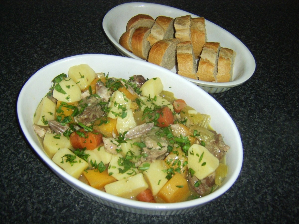 Stew is garnished and served with the bread