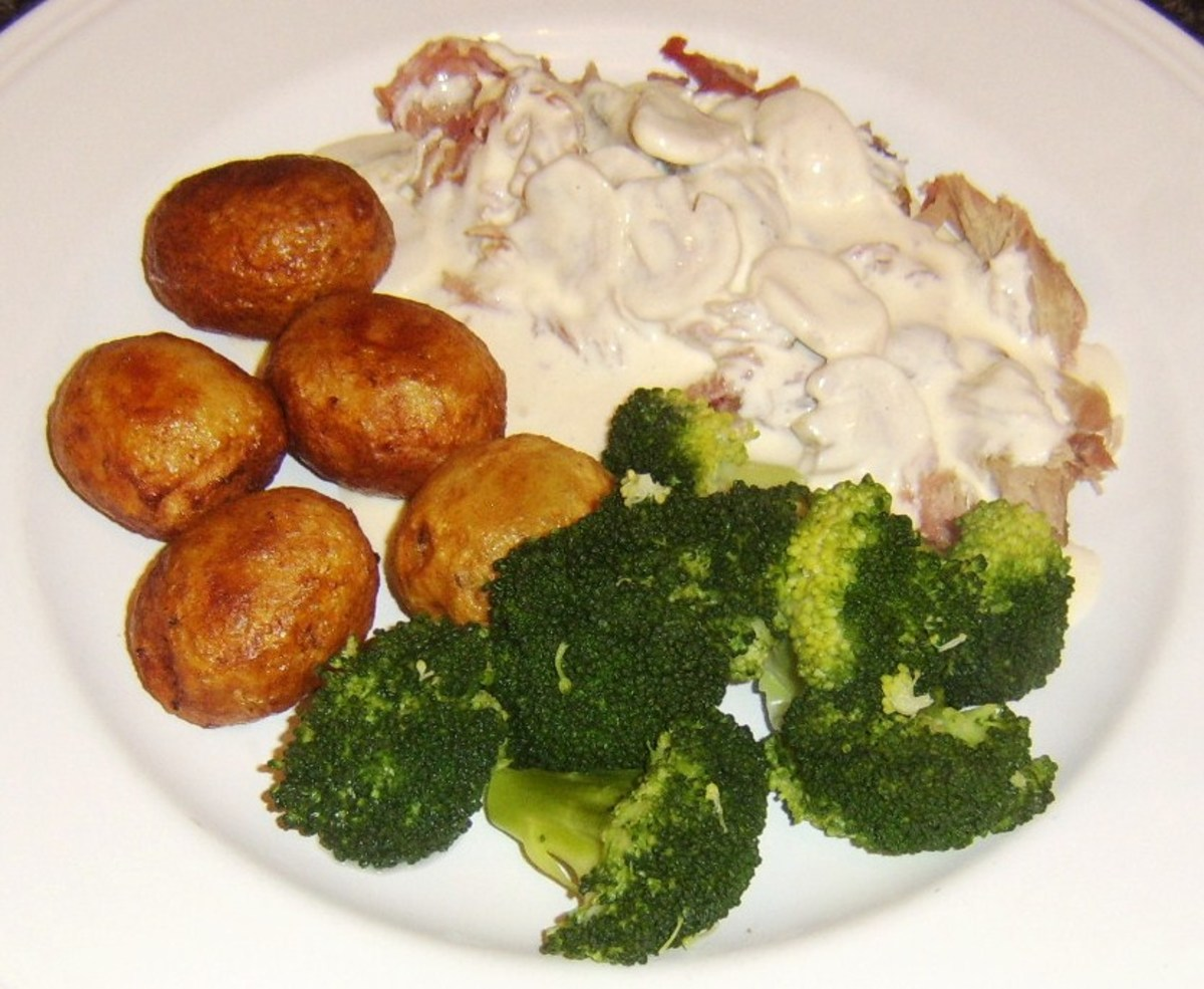 Roast rabbit saddle is plucked from the bones and served with mushroom cream sauce, roast potatoes and broccoli