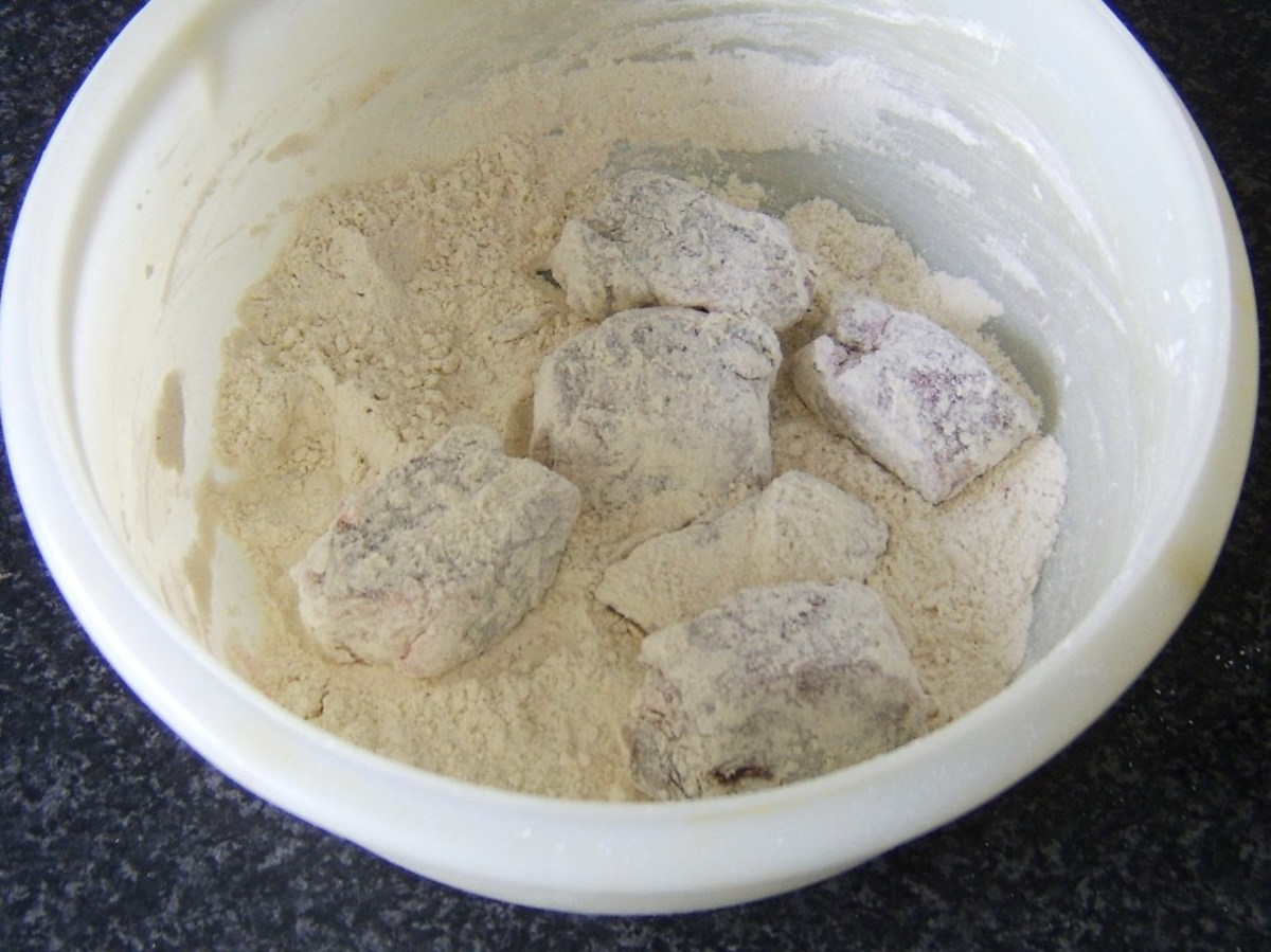 Lamb pieces are tossed in flour