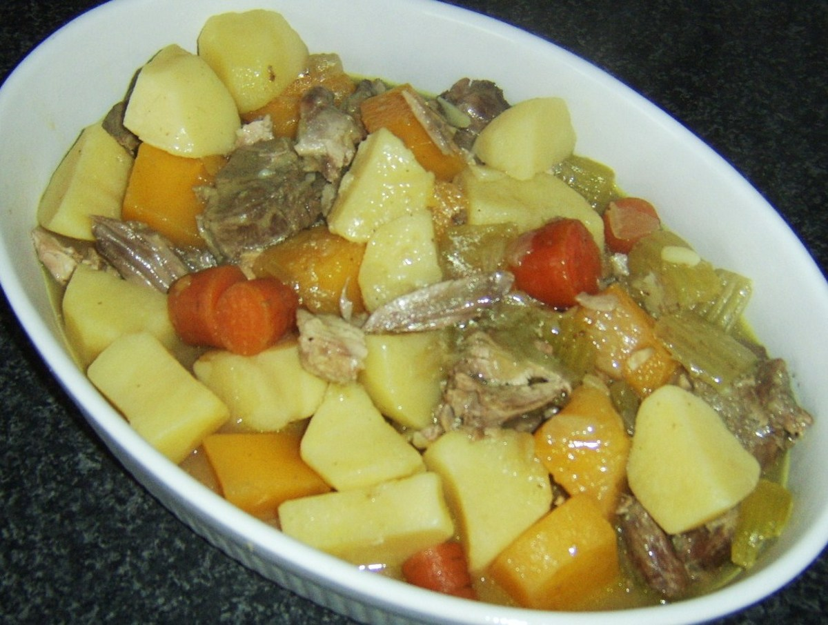 Rabbit and lamb stew is ladled in to serving dish