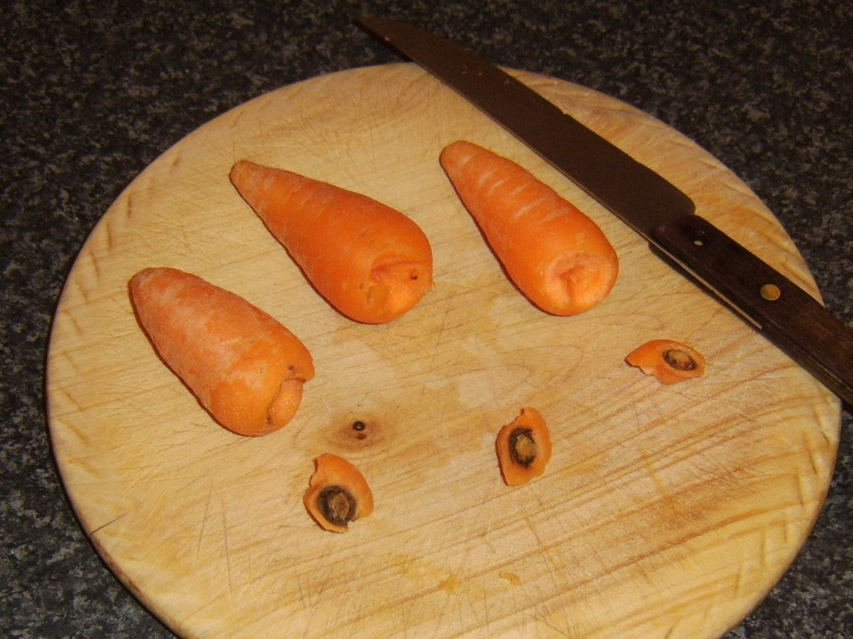 Tops are removed from carrots for cooking