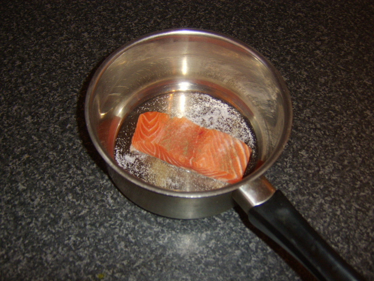 Preparing to poach salmon fillet