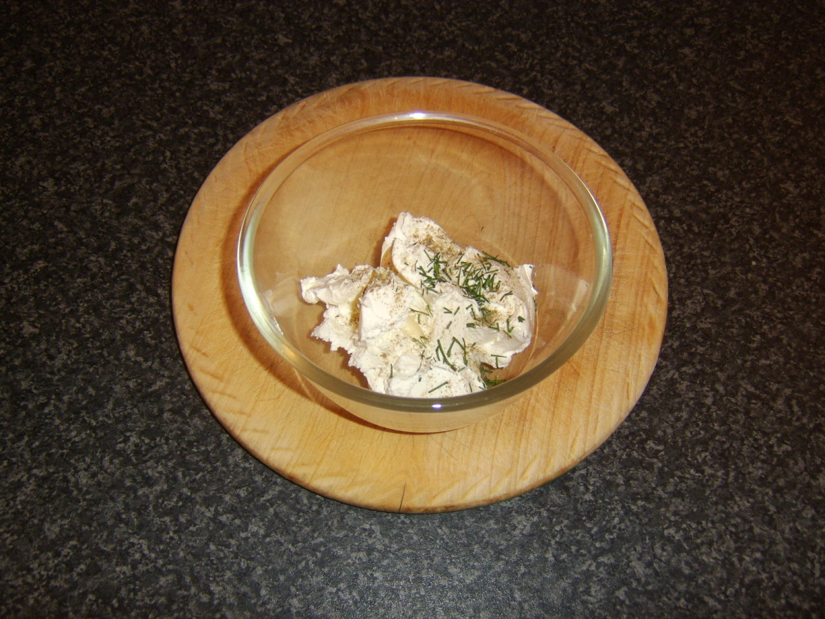 Fresh dill and white pepper are added to cream cheese
