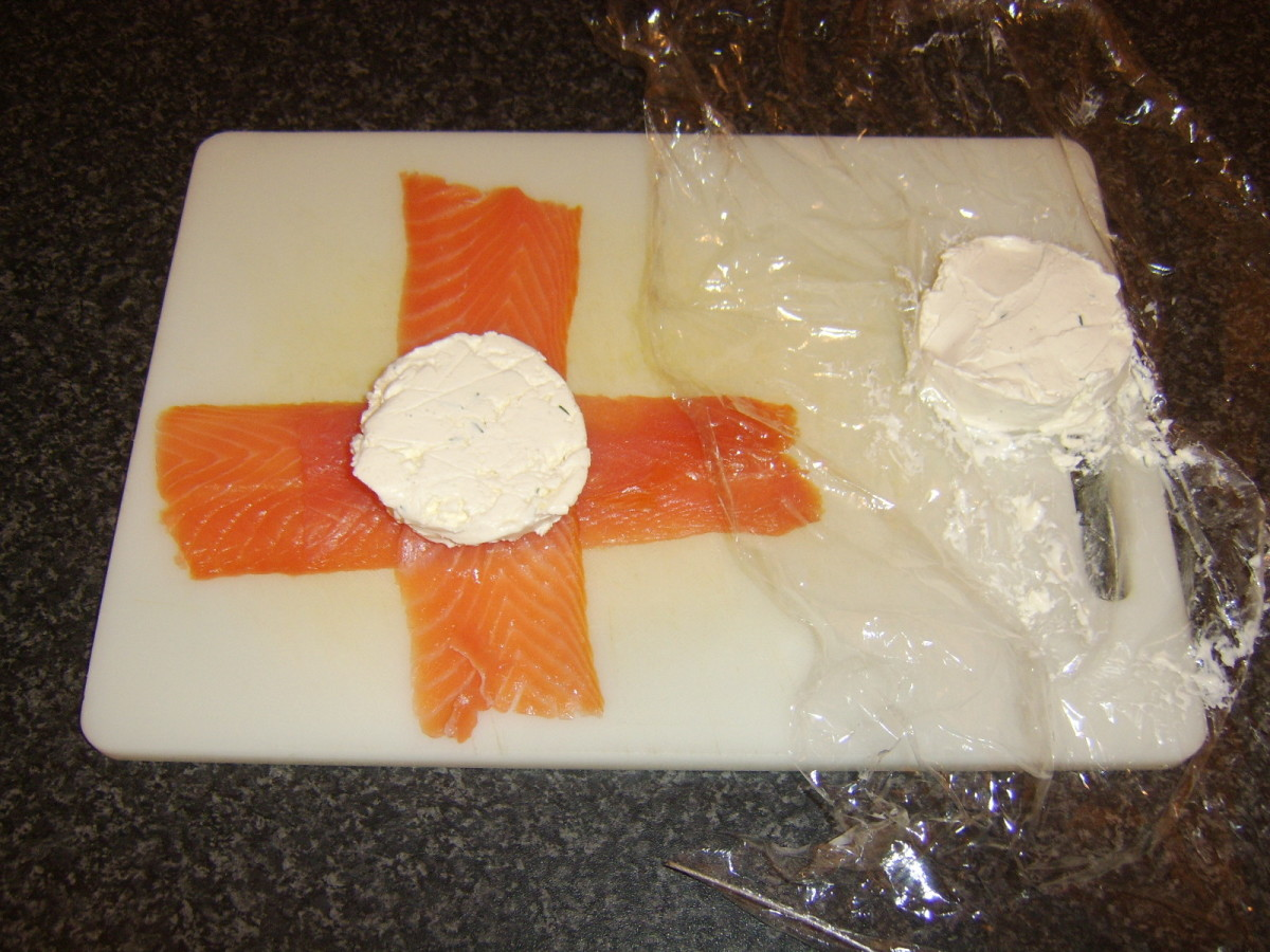 Cream cheese patty is laid on smoked salmon