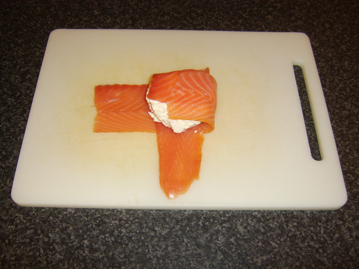 Smoked salmon is wrapped around the cream cheese patties