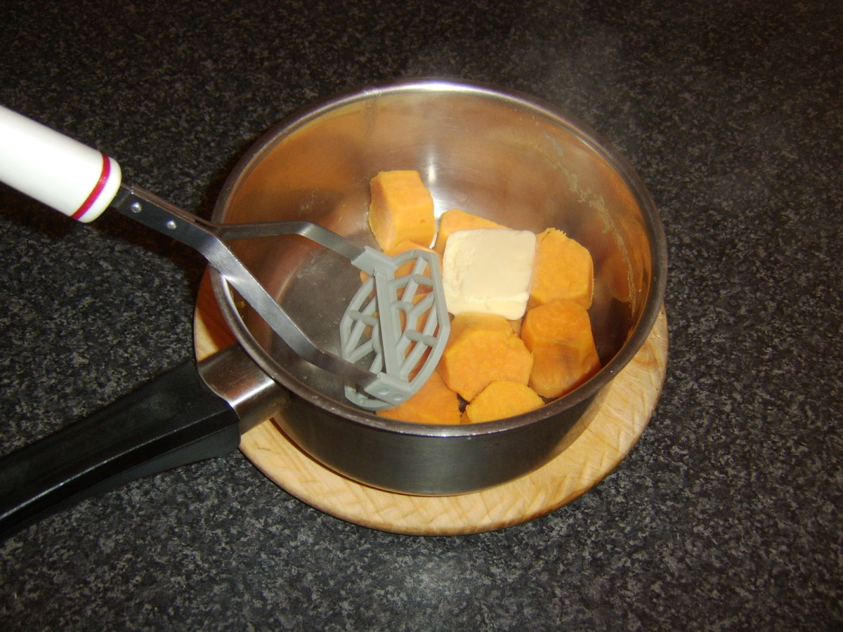 Sweet potatoes are mashed with butter and seasoning