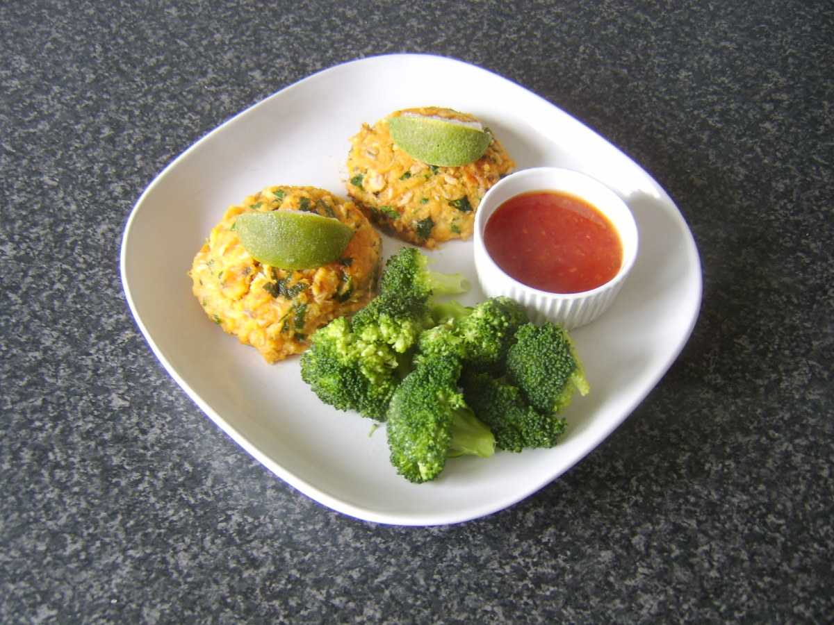 Spicy salmon and sweet potato cakes served with broccoli and sweet chilli dipping sauce